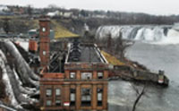 Cohoes hydroelectric plant with penstocks on left of picture and Cohoes Falls in top right